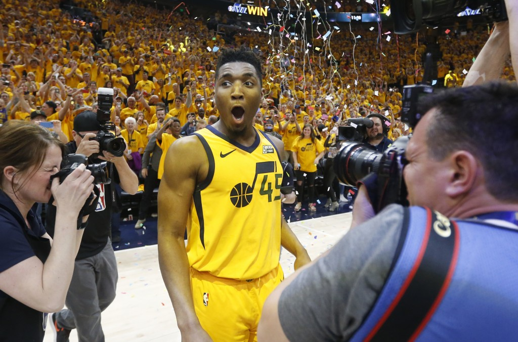 Utah Jazz guard Donovan Mitchell (45) celebrates after the team's 96-91 victory over the Oklahoma City Thunder during Game 6 of an NBA basketball firs...