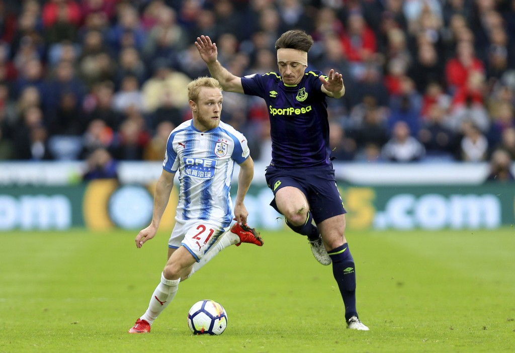 Everton's Leighton Baines, right, and Huddersfield Town's Alex Pritchard during their English Premier League soccer match at the John Smith's Stadium ...