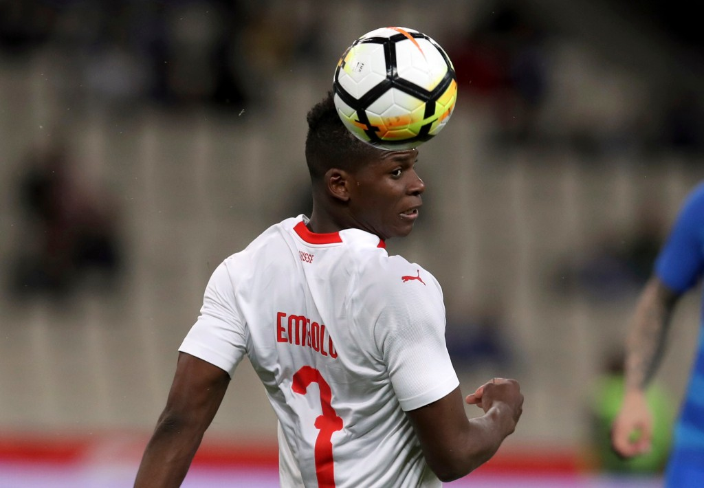 In this photo taken on Friday, March 23, 2018, Switzerland's Breel Embolo heads the ball during an international friendly soccer match at the Olympic ...
