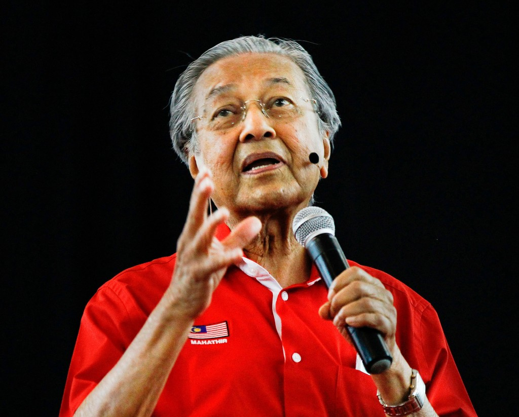 FILE - In this Aug. 13, 2017, file photo, former Malaysian Prime Minister Mahathir Mohamad speaks during a forum in Shah Alam, Malaysia. The May 9, 20...