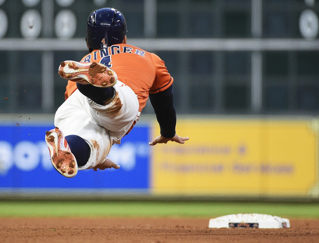 Houston Astros' George Springer advances to second on a fly out by Jose Altuve during the fourth inning of a baseball game against the Oakland Athleti...