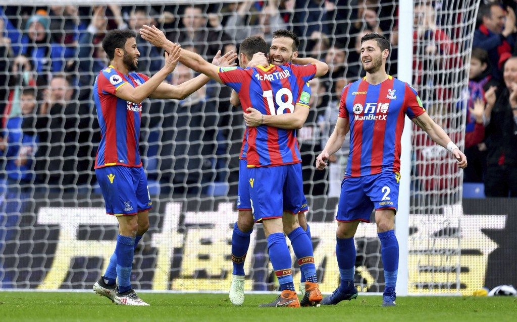 Crystal Palace's James McArthur, center, celebrates scoring his side's second goal of the game during their English Premier League soccer match Leices...