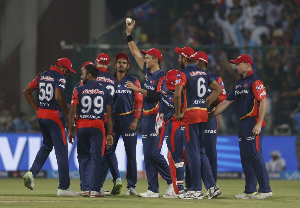 Delhi Daredevils' Trent Boult holds the ball as his teammate celebrate the wicket of Kolkata Night Riders' Dinesh Karthik during their VIVO IPL cricke...