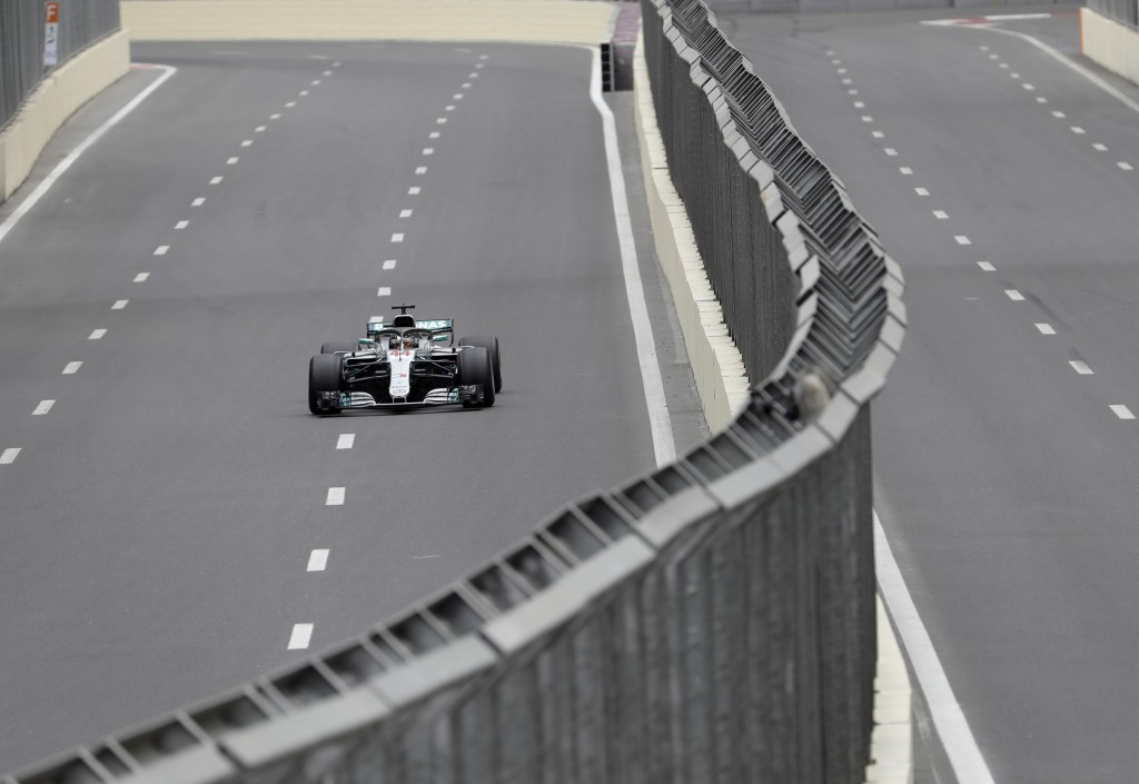 Mercedes driver Lewis Hamilton of Britain steers his car during the third free practice session at the Baku Formula One city circuit, in Baku, Azerbai...