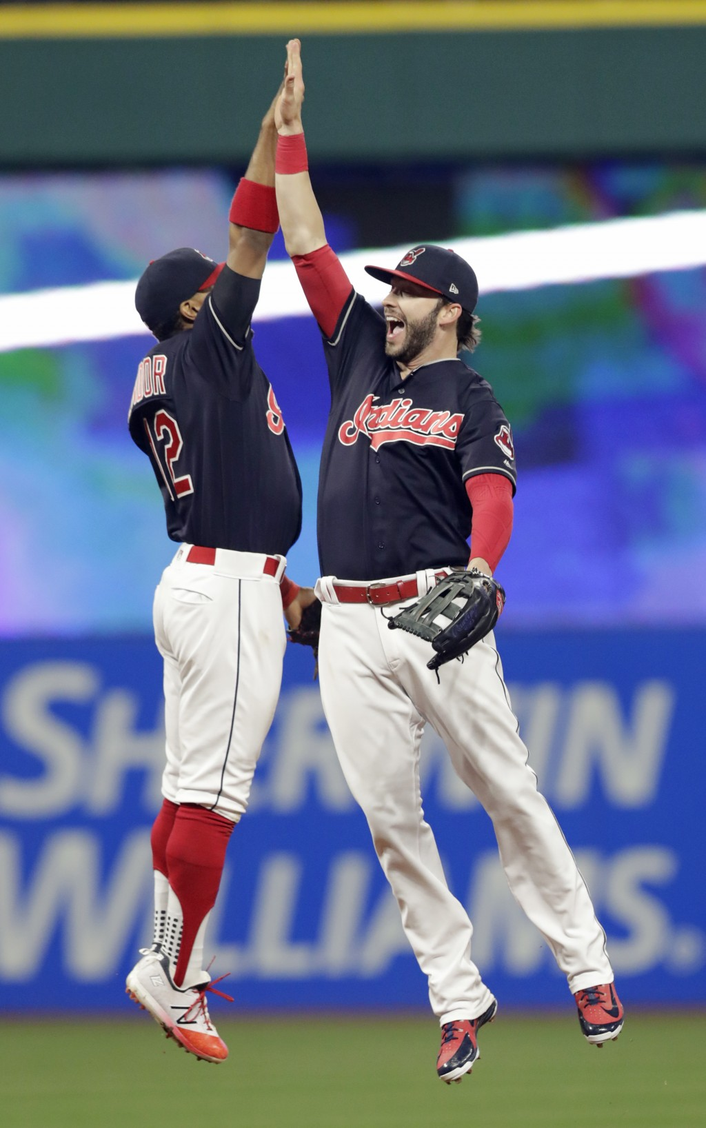 Cleveland Indians' Francisco Lindor, left, and Tyler Naquin celebrate after the Indians defeated the Seattle Mariners 6-5 in a baseball game Friday, A...