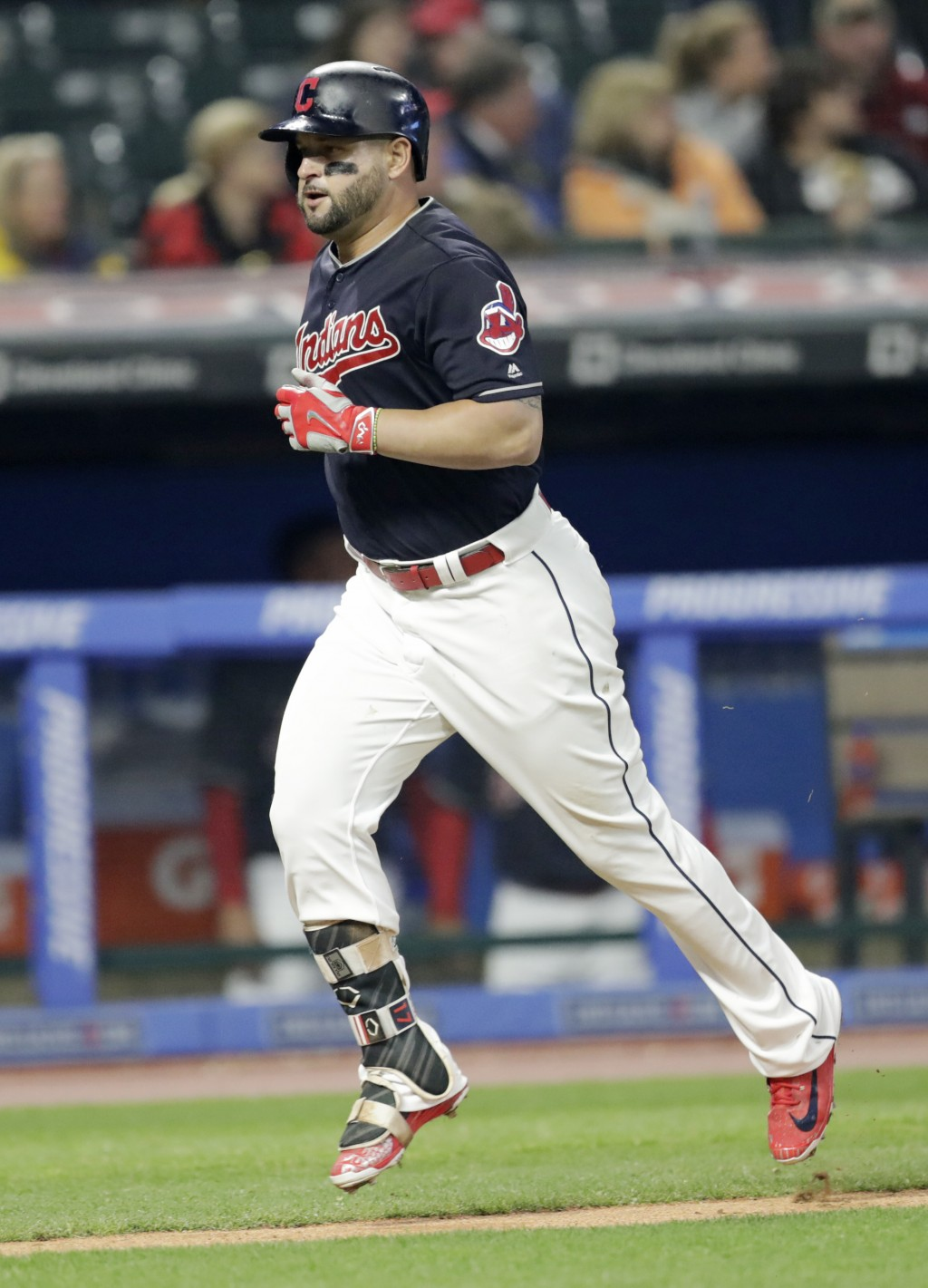 Cleveland Indians' Yonder Alonso runs the bases after hitting a solo home run off Seattle Mariners starting pitcher Erasmo Ramirez during the sixth in...
