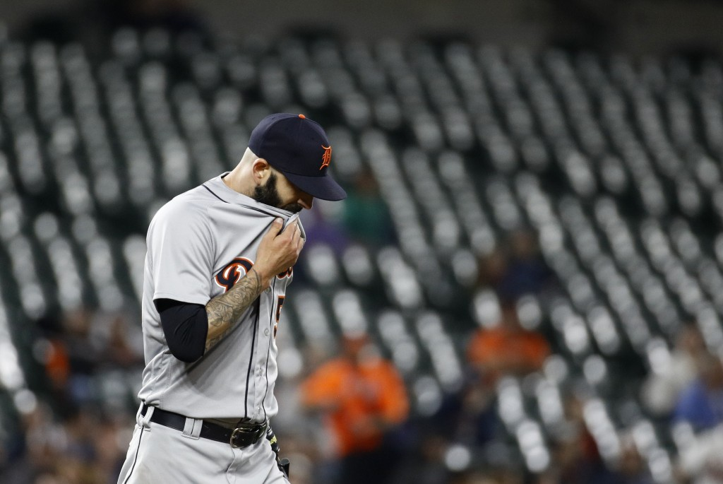 Detroit Tigers starting pitcher Mike Fiers pauses after Baltimore Orioles second baseman Jace Peterson stole third base during the sixth inning of a b...