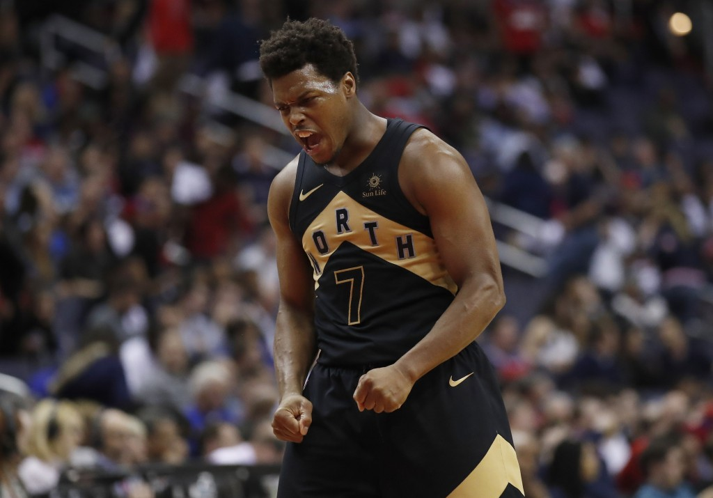 Toronto Raptors guard Kyle Lowry celebrates late in the second half of Game 6 of the team's NBA basketball first-round playoff series against the Wash...