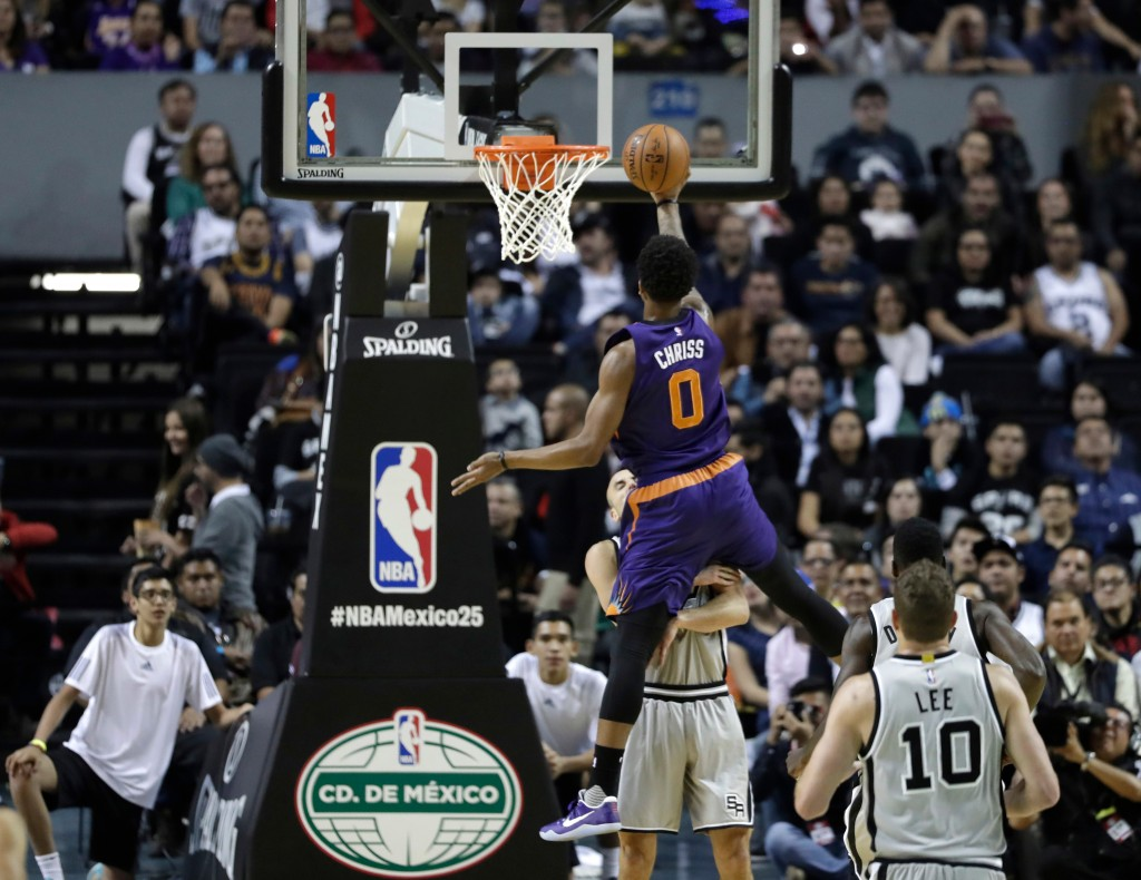FILE - In this Jan. 14, 2017, file photo, Phoenix Suns' Marquese Chriss does a layup against the San Antonio Spurs in the first half of their regular-...