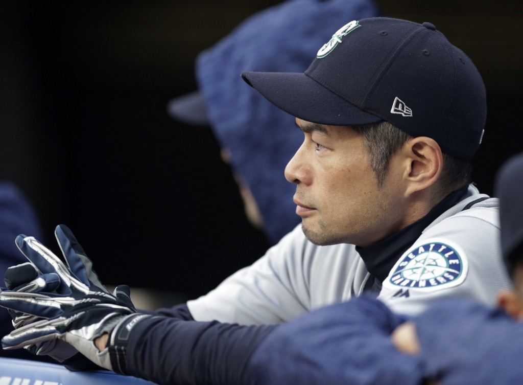 Seattle Mariners' Ichiro Suzuki watches from the dugout during the second inning of the team's baseball game against the Cleveland Indians, Friday, Ap...