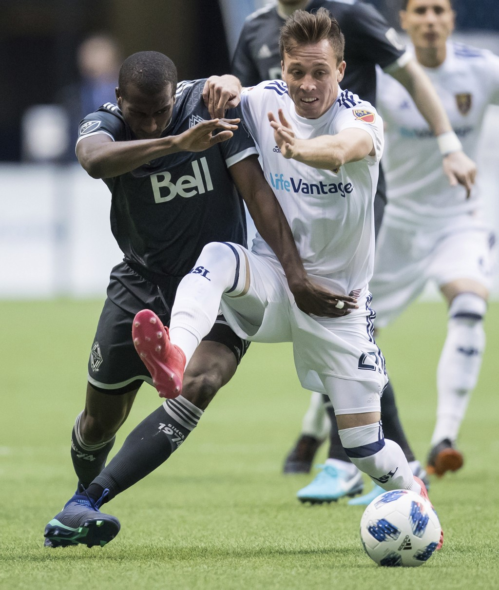 Vancouver Whitecaps' Ali Ghazal, left, and Real Salt Lake's Corey Baird vie for the ball during the first half of an MLS soccer match Friday, April 27...