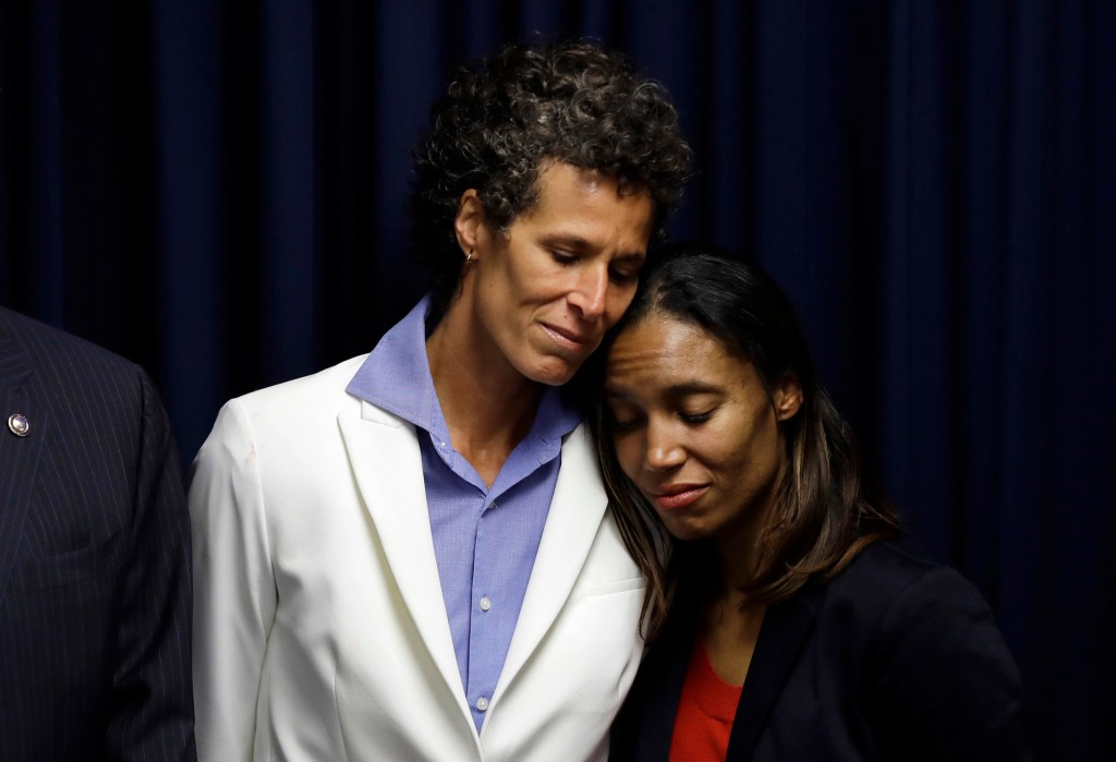 Bill Cosby accuser Andrea Constand embraces prosecutor Kristen Feden, right, during a news conference after Cosby was found guilty in his sexual assau...
