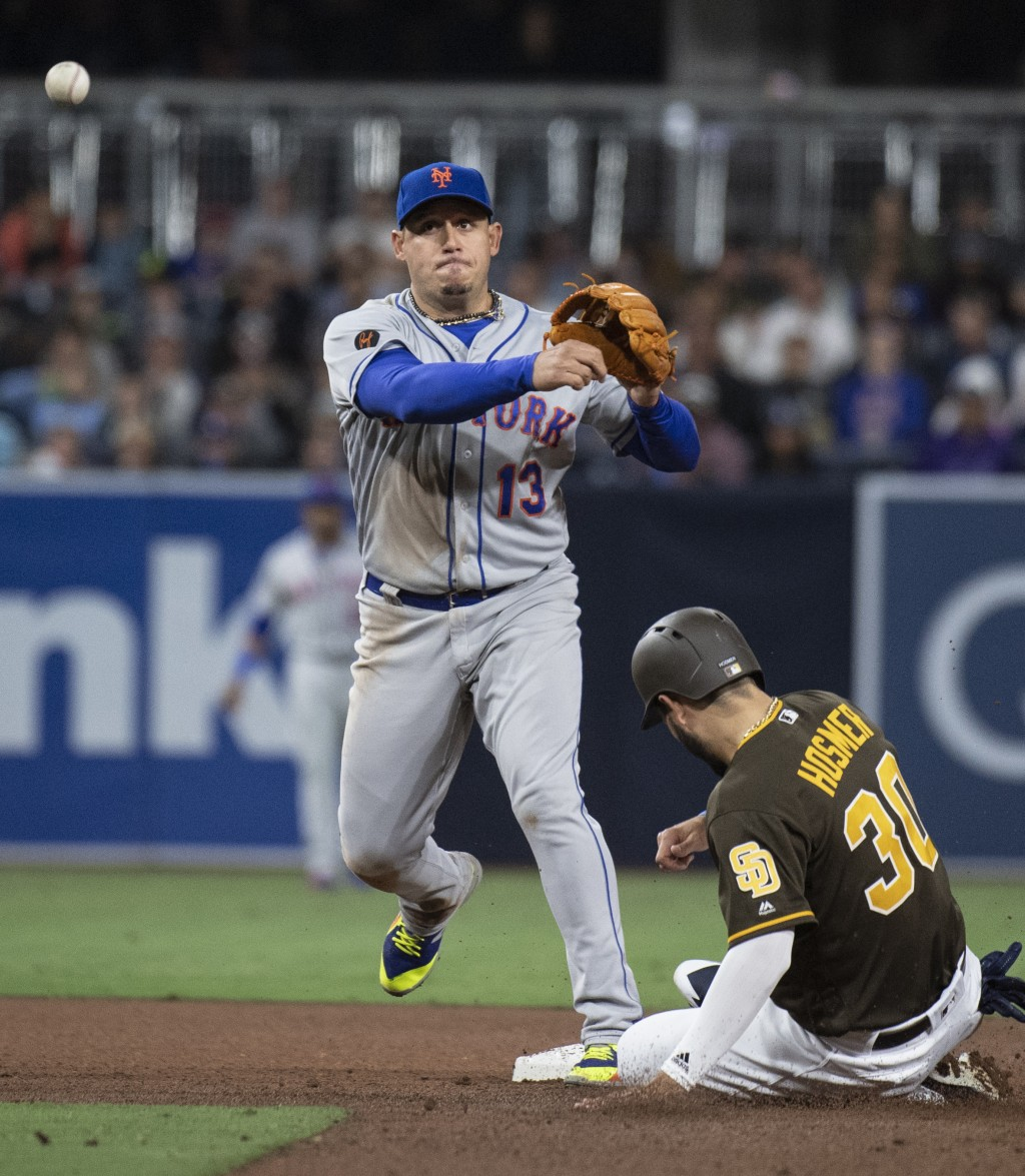 New York Mets second baseman Asdrubal Cabrera, left, turns a double play over a slide by San Diego Padres' Eric Hosmer during the fourth inning of a b...