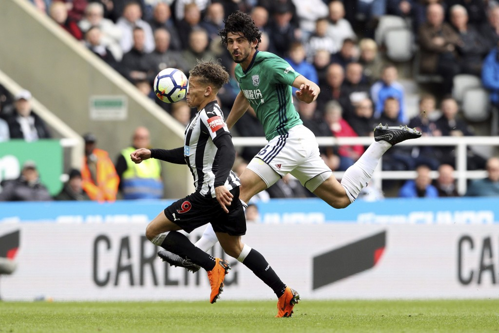 West Bromwich Albion's Ahmed Hegazi, centre right and Newcastle United's Dwight Gayle battle for the ball , during the English Premier League soccer m...