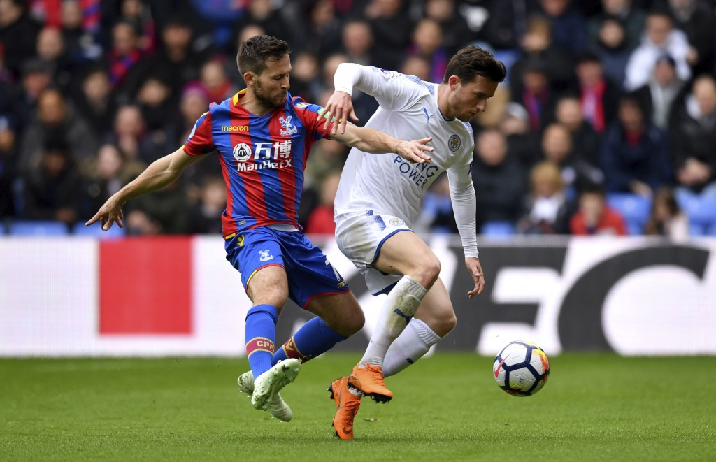 Crystal Palace's Yohan Cabaye, left, and Leicester City's Ben Chillwell battle for the ball during their English Premier League soccer match at Selhur...