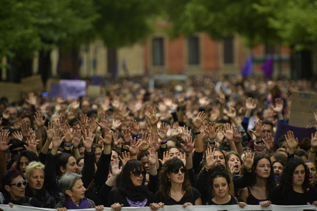 Women hold up their hands as they shout slogans during a protest in Pamplona, northern Spain, Saturday, April 28, 2018. Women's rights groups protest ...