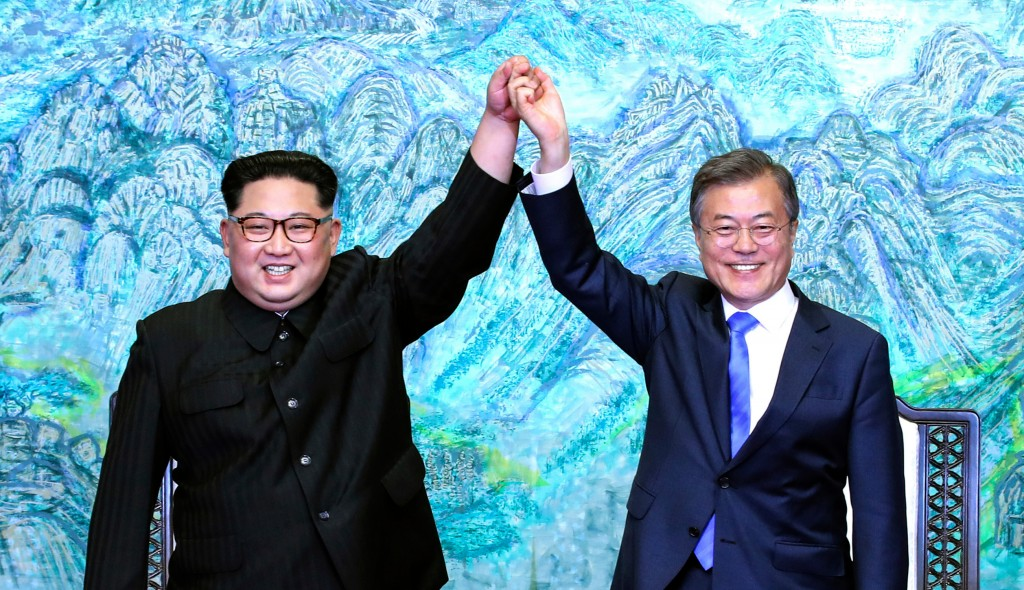 FILE - In this Friday, April 27, 2018, file photo, North Korean leader Kim Jong Un, left, and South Korean President Moon Jae-in raise their hands aft...