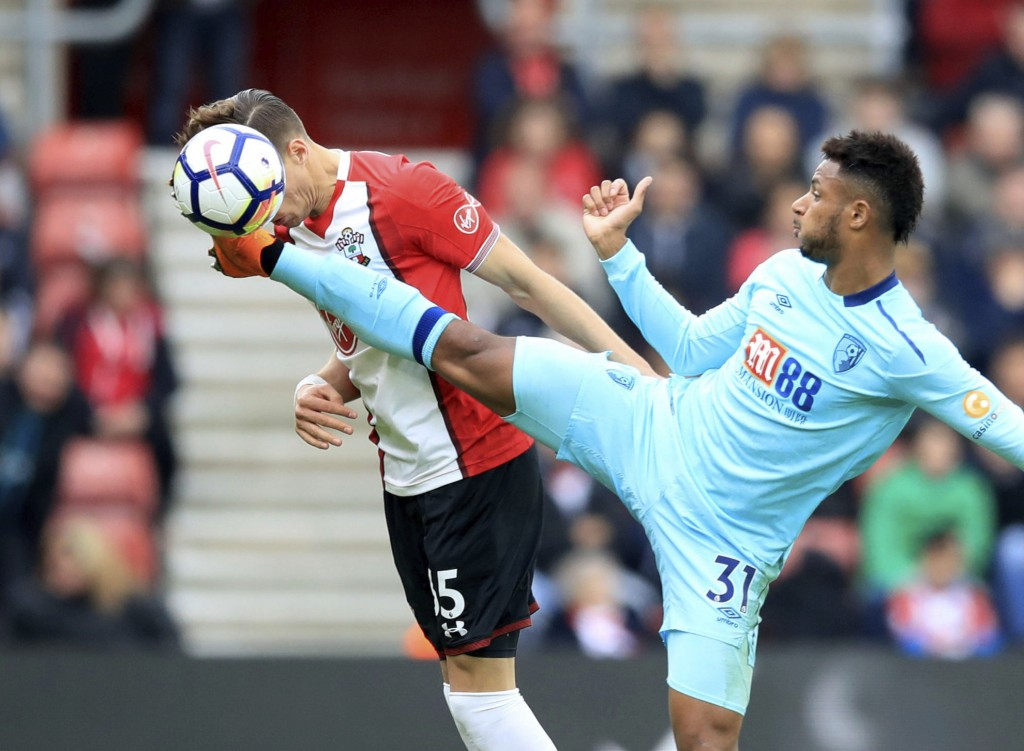 Southampton's Jan Bednarek, left, and AFC Bournemouth's Lys Mousset during the English Premier League soccer match at St Mary's in Southampton, Englan...
