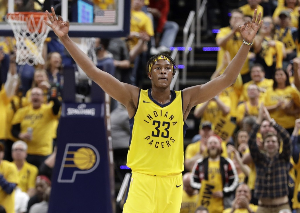Indiana Pacers' Myles Turner celebrates during the second half of Game 6 of a first-round NBA basketball playoff series against the Cleveland Cavalier...
