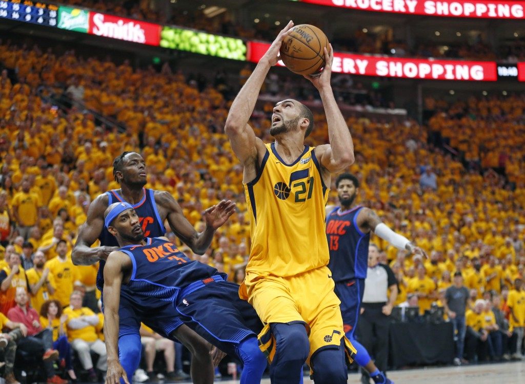 Oklahoma City Thunder forward Corey Brewer (3) fouls Utah Jazz center Rudy Gobert (27) in the second half during Game 6 of an NBA basketball first-rou...