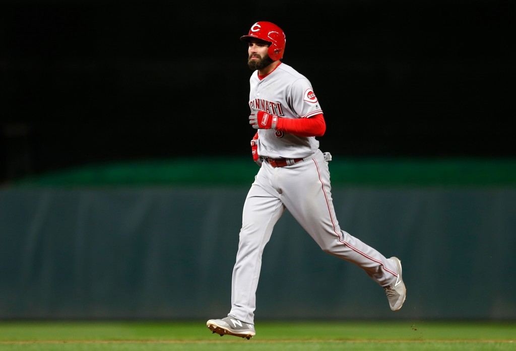 Cincinnati Reds' Jose Peraza rounds the bases on a solo home run by Minnesota Twins pitcher David Hale during the ninth inning of a baseball game Frid...