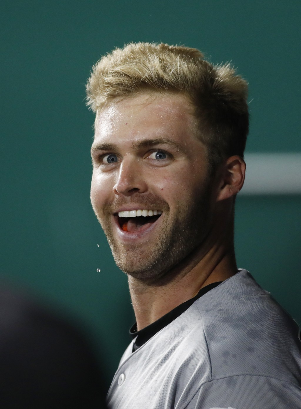 Chicago White Sox designated hitter Matt Davidson celebrates in the dugout after hitting a two-run home run in the 11th inning of a baseball game agai...