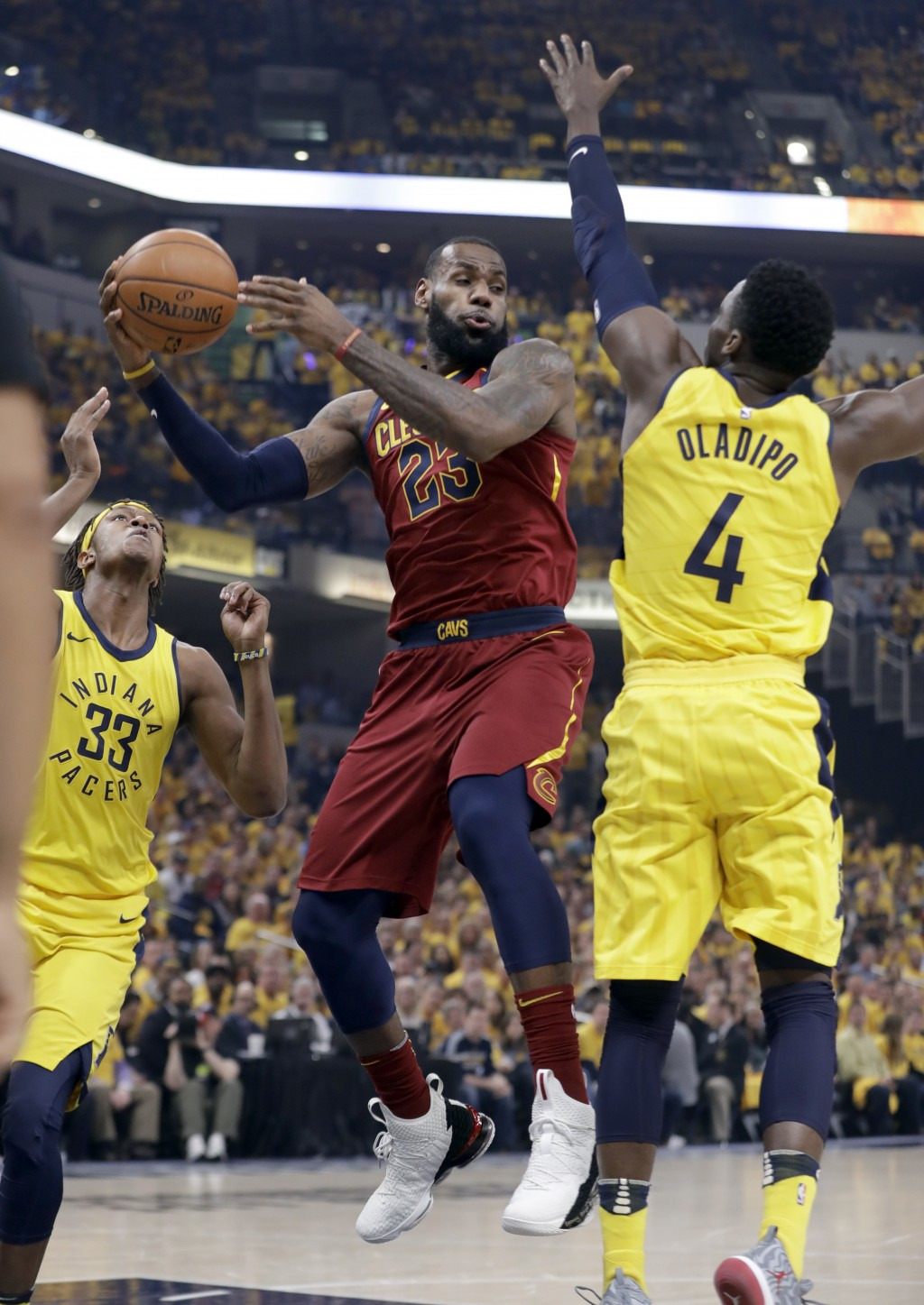 Cleveland Cavaliers' LeBron James (23) passes as Indiana Pacers' Victor Oladipo (4) and Myles Turner (33) defend during the first half of Game 6 of a ...