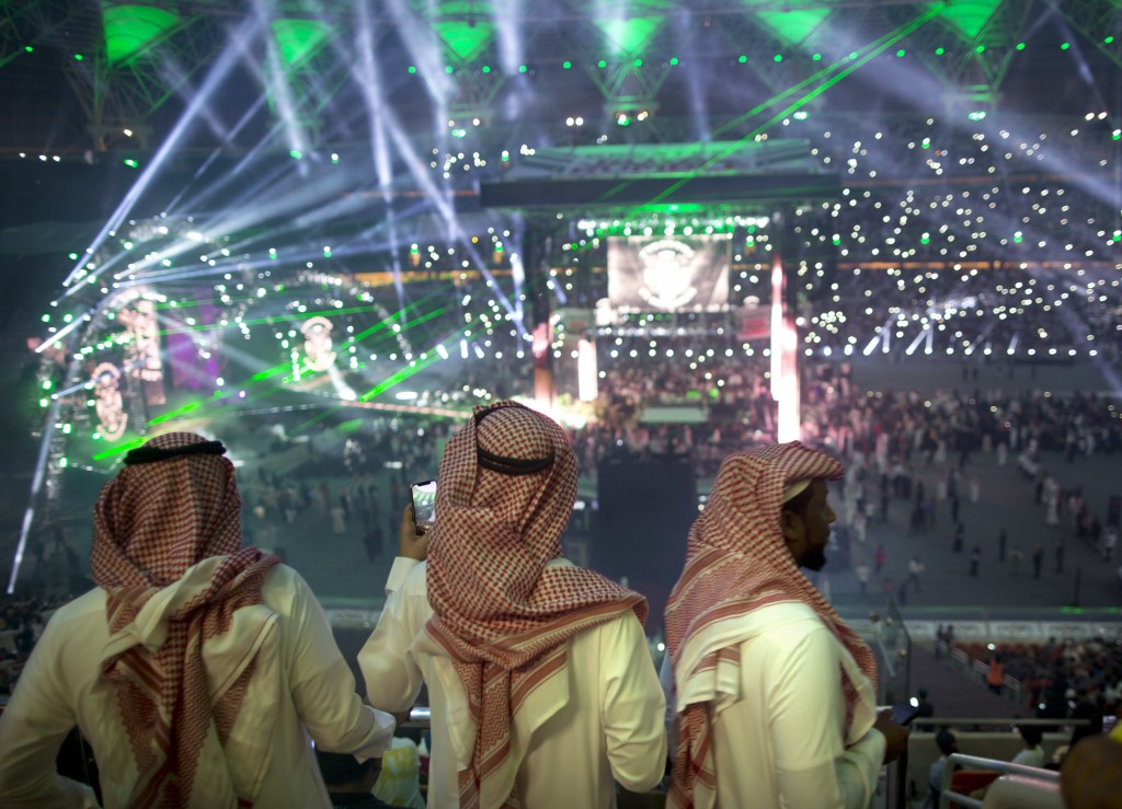 "Fans film the opening of the ""Greatest Royal Rumble"" event in Jiddah, Saudi Arabia, Friday, April 27, 2018. A previous WWE event held in the ultracons..."