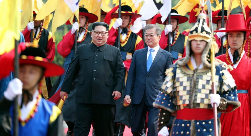 In this Friday, April 27, 2018, file photo, North Korean leader Kim Jong Un, left, and South Korean President Moon Jae-in, right, walk together throug...