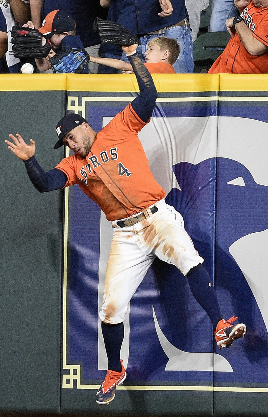 Houston Astros right fielder George Springer can't catch a two-run home run by Oakland Athletics' Mark Canha during the seventh inning of a baseball g...