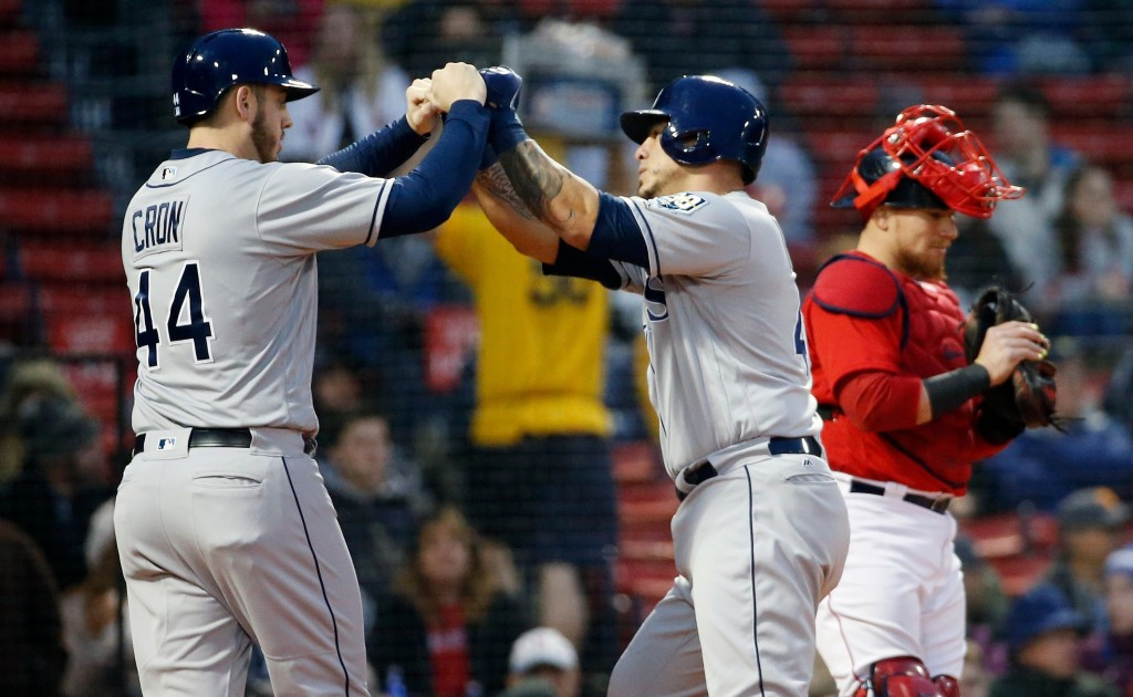 Tampa Bay Rays' Wilson Ramos, center, celebrates his two-run home run that also drove in C.J. Cron (44) as Boston Red Sox's Christian Vazquez looks at...