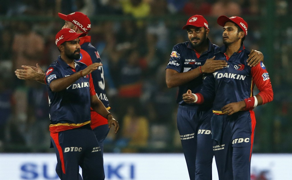 Delhi Daredevils' captain Shreyas Iyer, right, is congratulated by his teammates after he took catch to dismiss Kolkata Night Riders' Sunil Narine dur...