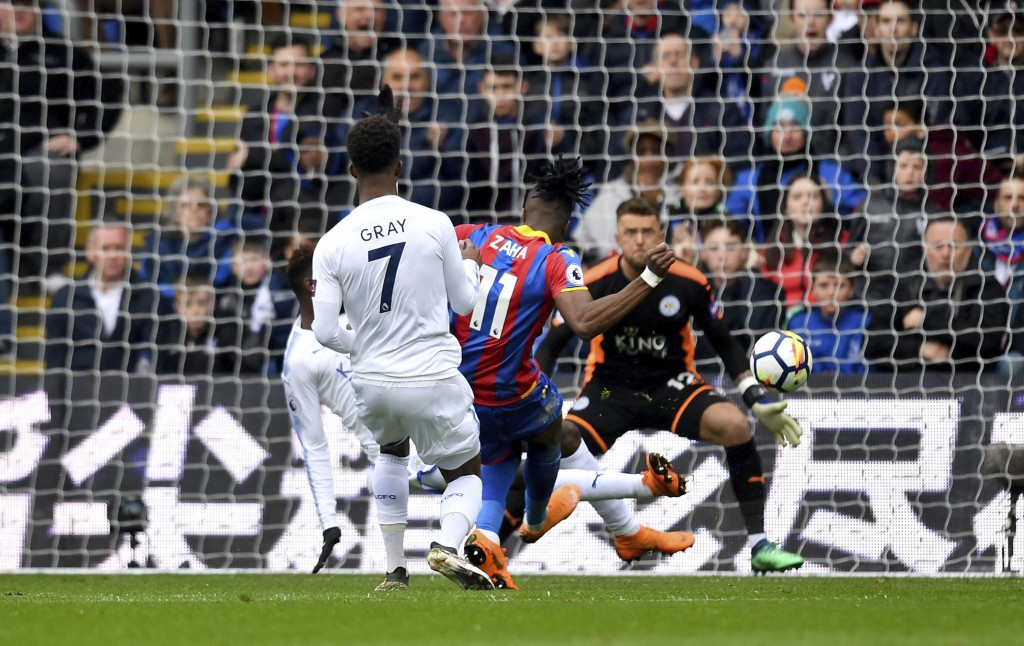 Crystal Palace's Wilfried Zaha, center, scores his side's first goal of the game during their English Premier League soccer match against Leicester Ci...