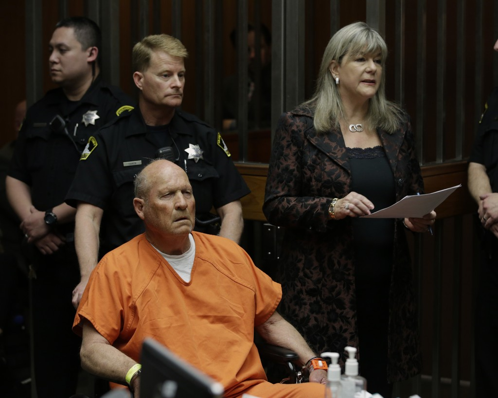 Sacramento Public Defender Diane Howard, right, representing Joseph James DeAngelo, who faces charges that include homicide and rape, responds to a ju...