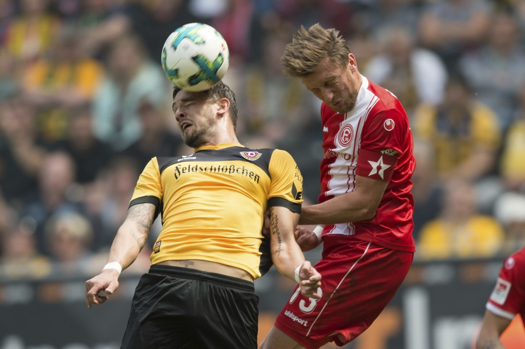 Dynamo's Pascal Testroet, left, and Duesseldorf's Adam Bodzek challenge for the ball during the German second division soccer match between Dynamo Dre...