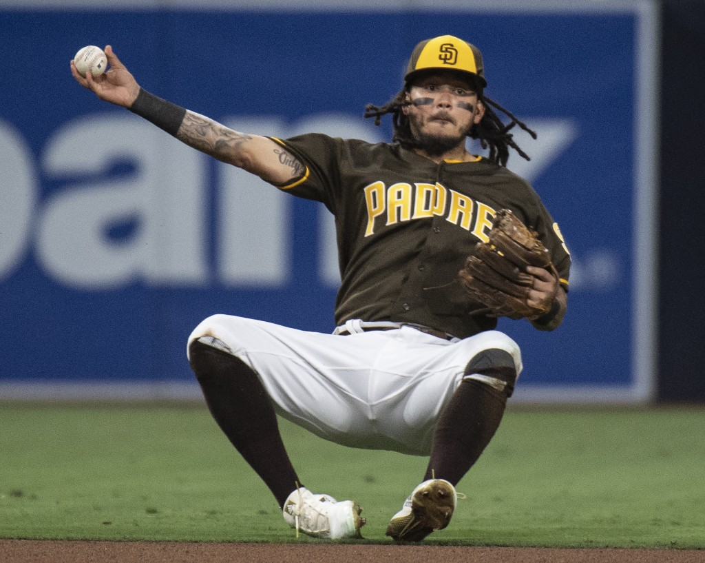 San Diego Padres shortstop Freddy Galvis throws to get a force-out at second base during the fourth inning of a baseball game against the New York Met...
