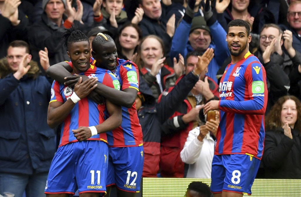 Crystal Palace's Wilfried Zaha, left, celebrates scoring his side's first goal of the game with teammate Mamadou Sakho during their English Premier Le...