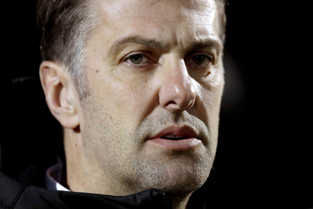 In this photo taken on Tuesday, March 27, 2018, Serbia coach Mladen Krstajic stands bon the pitch before the international friendly soccer match betwe...