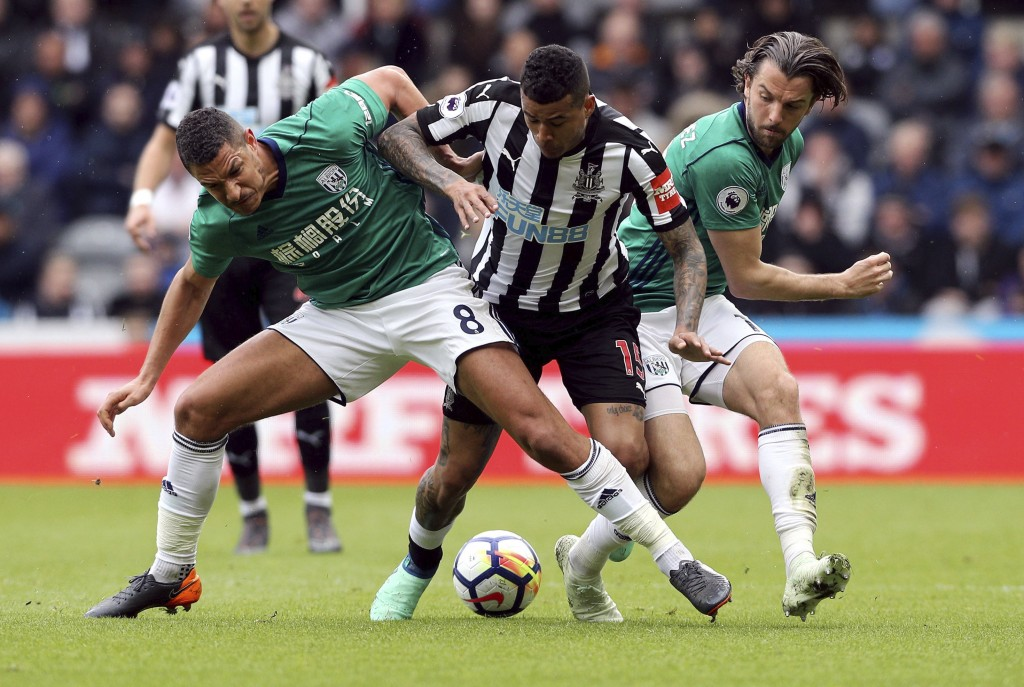 Newcastle United's Kenedy, centre,  battles for the ball with West Bromwich Albion's Jake Livermore, left and Jay Rodriguez during the English Premier...