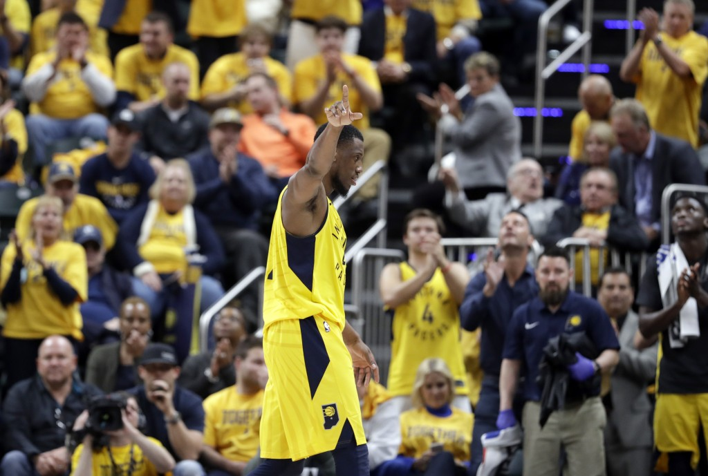 Indiana Pacers' Thaddeus Young waves to the crowd as he leaves the second half of Game 6 of a first-round NBA basketball playoff series against the Cl...