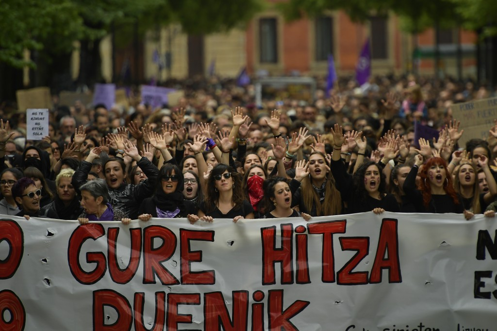 Women hold up a sign reading in basque language, ''Our Word'' as they shout slogans during a protest against sexual abuse in Pamplona, northern Spain,...