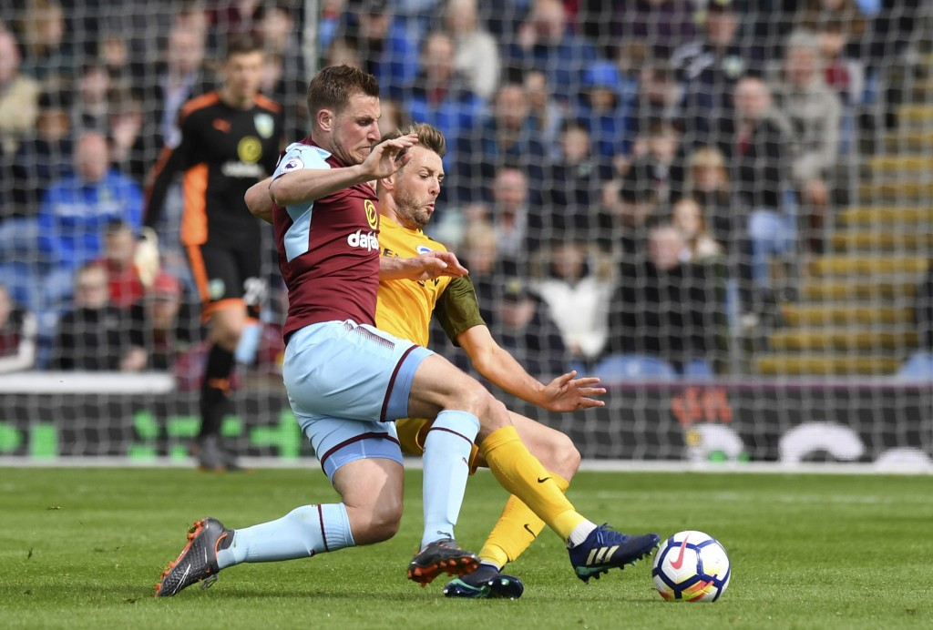 Burnley's Chris Wood, left, and Brighton and Hove Albion's Dale Stephens in action during their English Premier League soccer match at Turf Moor in Bu...