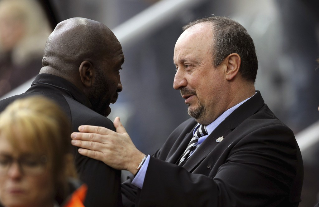 Newcastle United manager Rafael Benitez, right, greets West Bromwich Albion caretaker manager Darren Moore ahead of the English Premier League soccer ...