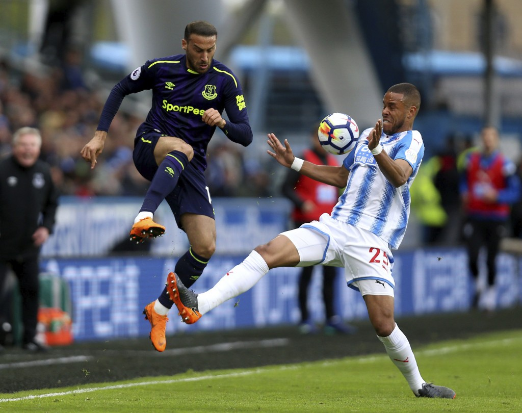 Huddersfield Town's Mathias Jorgensen, right, attempts to keep the ball from Everton's Cenk Tosun, during their English Premier League soccer match at...
