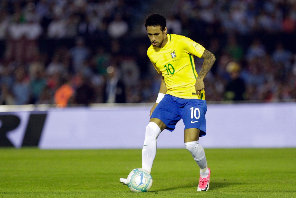 In this photo taken on Thursday, March 23, 2017, Brazil's Neymar controls the ball during a 2018 World Cup qualifying soccer match against Uruguay in ...
