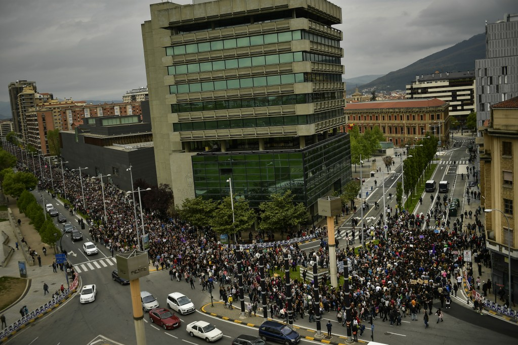 Some thousands of people march along an avenue during a protest against sexual abuse in Pamplona, northern Spain, Saturday, April 28, 2018. Women's ri...