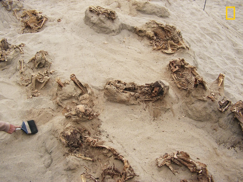 This April 22, 2011 handout photo provided by National Geographic shows more than a dozen bodies preserved in dry sand for more than 500 years, at the...