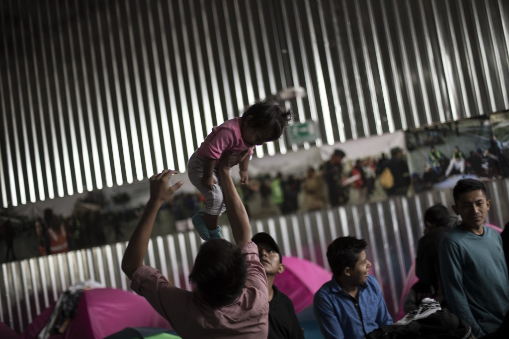 Migrants rise early in the morning and get ready, at the Juventudes 2000 Shelter, prior to meeting with immigration lawyers, in Tijuana Mexico, Friday...