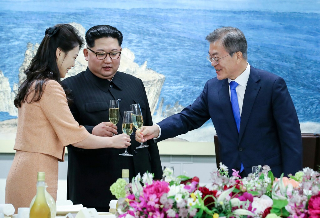 FILE - In this April 27, 2018 file photo, South Korean President Moon Jae-in, right, toasts with Ri Sol Ju, wife of North Korean leader Kim Jong Un du...