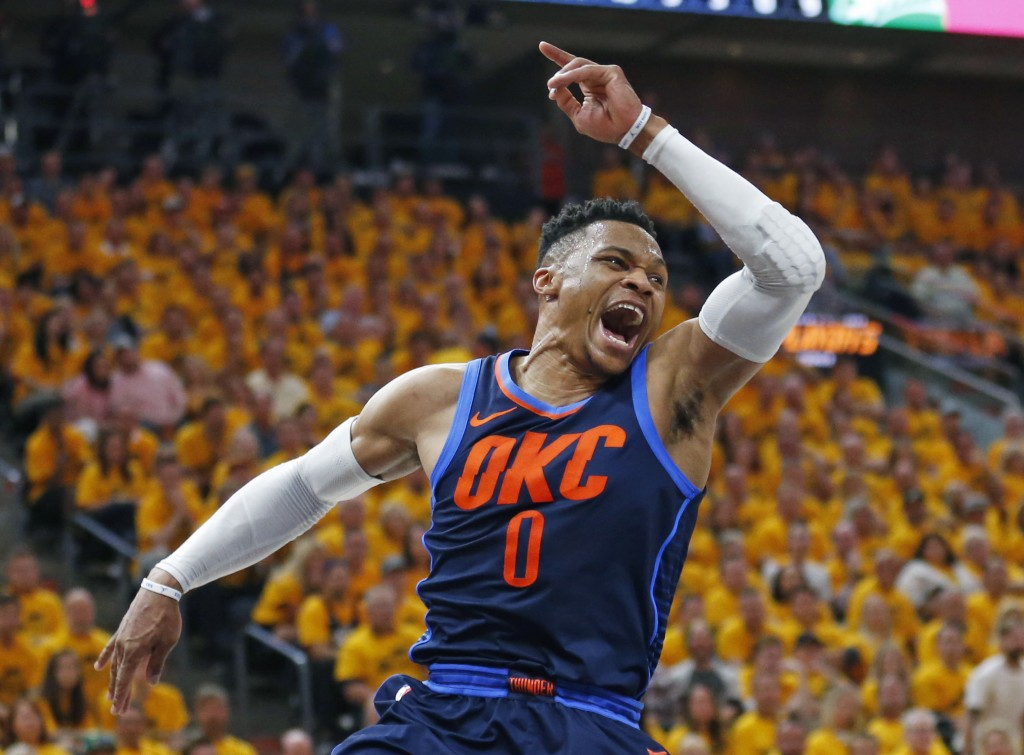 Oklahoma City Thunder guard Russell Westbrook celebrates a dunk against the Utah Jazz during the first half of Game 6 in an NBA basketball first-round...